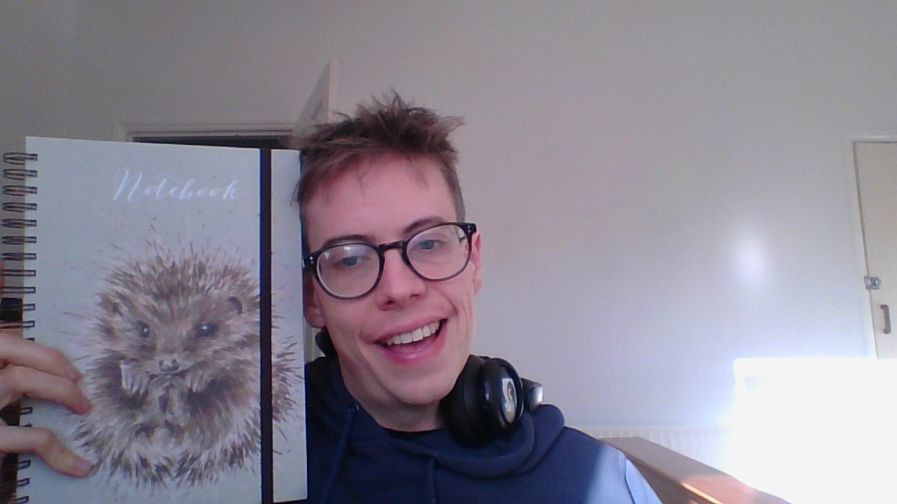 Jorik with Hedgehog notebook